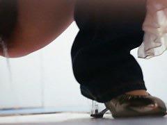Public bathroom spy camera catches an Asian girl pissing