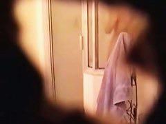 Shower spy cam gets mature and hot brunette