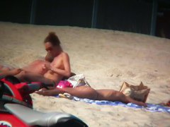 Sexy blonde and naughty brunette on nude beach