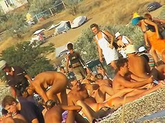 Naked hotties showing their pussies at the beach