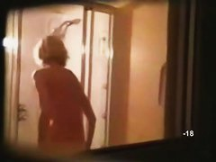 Hidden shower videos feature a sexy, moist blond girl.