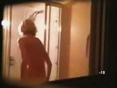 Hidden shower videos feature a sexy, moist blond girl.