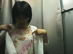 Hidden camera in changing room shows a hot bodied Asian girl.