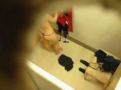 Hidden camera in changing room gets naked brunette
