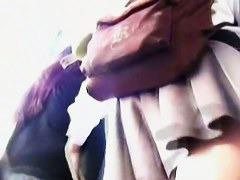 Lilac panties revealed in a street upskirt voyeur hunt