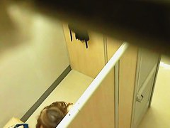 Spy cam in a changing room ceiling captures some tits