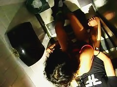 Voyeur cam from above catches a couple fucking in a bathroom stall