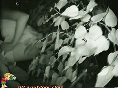 A nightcam voyeur video of a girl pissing in the bushes