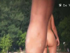 Stunning nude female body caught on a beach voyeur video
