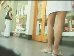 Upskirt loving voyeur sneaks up next to the unsuspecting girls