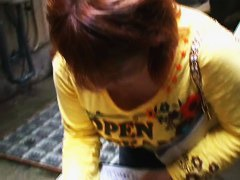 Chubby redhead Japanese shows her cleavage on candid cam video