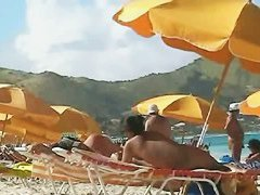 Beach voyeur video of a nude milf and a nude Asian hottie