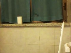 Hidden home cam catches a sexy girl pissing in a toilet bowl
