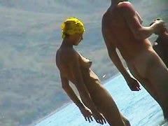 Skillful voyeur smuggled a camera to a nudist beach