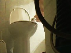Peeing hidden cam captures babe emptying her bladder on the toilet