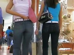 Two sexy babes in tight jeans strolling in the mall