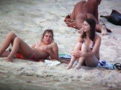 Beach spy voyeur captures two friends sunbathing topless