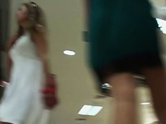 Boutique upskirt duo shows their panties for a spy cam