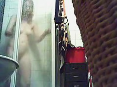 Bathroom spy cam records a blonde pissing and then showering