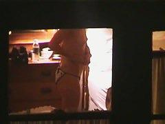 A crafty voyeur window shot of a girl in cow panties