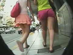 Two girl in skirt and shorts have very good butts