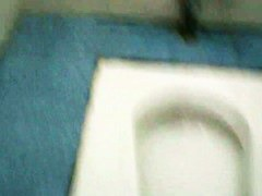 Sexy slut in sport outfit is pissing in the clean public toilet