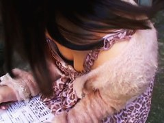 Cute asian babe with nice figure is filmed in a downblouse show