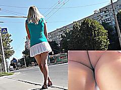 Alluring blond caught by upskirt web camera