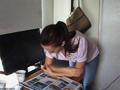 Brunette vixen reading a paper in a down blouse video