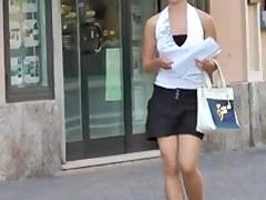 Braless street cute girl walking and bouncing