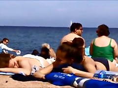 Young topless teens on Barcelona spanish beach