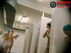 Skinny brunette and friends naked on a voyeur bathroom cam