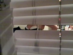 Real amateur nudity spied through the louvers on window