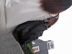 Girl in white dress wonderful upskirt on the avenue