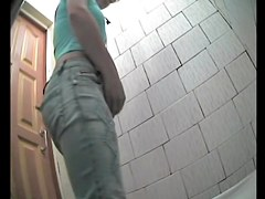 Butt cheeks of the pissing amateur spreading on spy cam