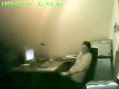 Raunchy security cam masturbation from the office cutie