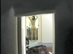Spy cam scenes with topless girl in the hotel room
