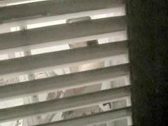 Trying to voyeur nudity details through the window blinds