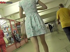 Upskirting slender young babe in the gentle dress