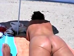 Naked ass and pussy slits admired by beach voyeur hunter