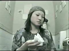 Asian girl flashing the nub on the toilet cam