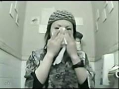 Asian girl flashing the nub on the toilet cam