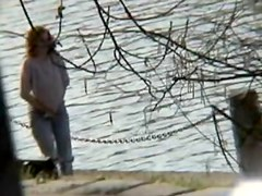 Amateur milf caught pissing on the river bank