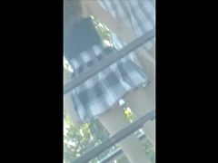 Dude lifts the skirt of his gf and shows her panty upskirt