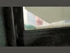 Neighbor is exposing her nice cunt through the window