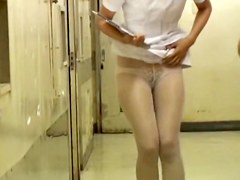 White pantyhose and sexy panty on Japanese nurse in video
