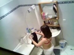 Gorgeous brunette getting ready to take hidden shower