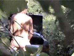 Having hid in the bushes fucking couple gets on spy cam