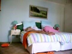 Milf stretching on bed and enjoying spy cam masturbating