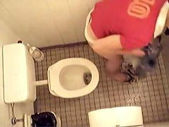 Naked girl is pissing on the hidden cam in the toilet
